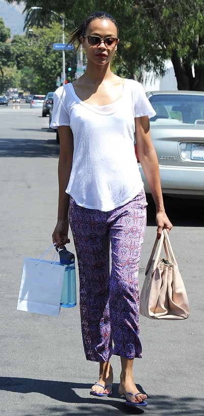 A casual looking Zoe Saldana is seen leaving a private residence in West Hollywood